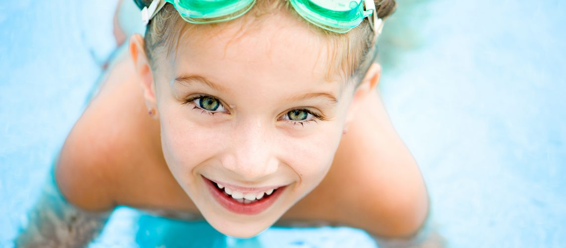 Pretty little girl in swimming pool